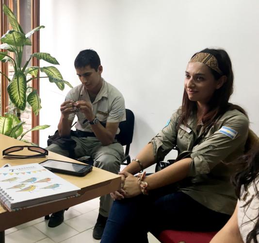 Sebastián Ortega takes a closer look at the satellite tag, with Paula Martínez enjoying the discussion.