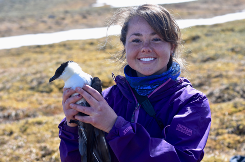 Emily Williams, Avian Ecologist, Denali National Park, holding a Long-tailed Jaeger